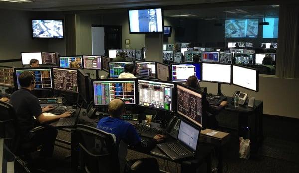people working on digital computers